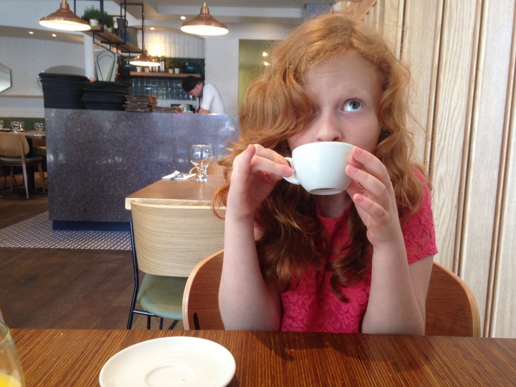 Daughter drinking coffee