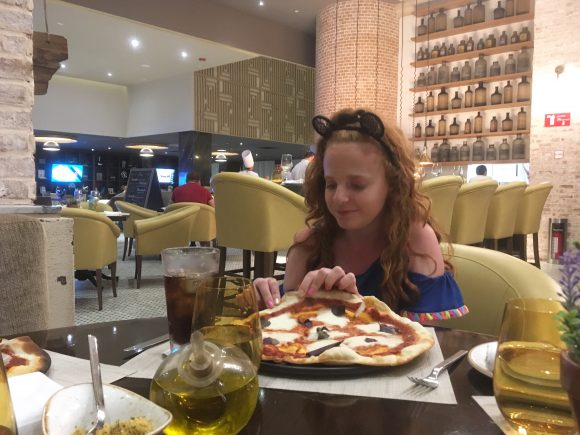 Daughter eating Pizza