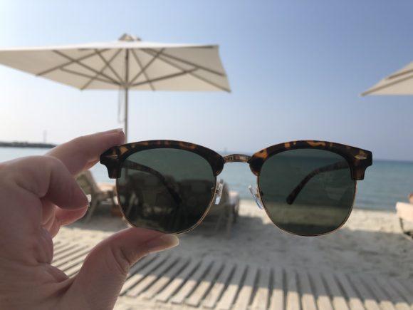 Sunglasses on the beach at Sani